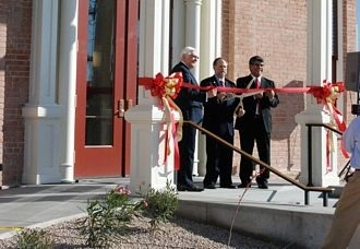 Supervisor Clark Smithson, Chairman David Snider and Supervisor Pete Rios prepare to cut the ribbon to open the 1891 Courthouse.