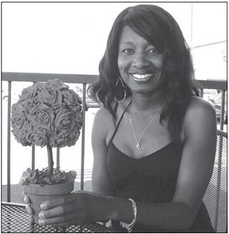 "Yolanda Smith of Mia Bella Cupcakes with one of her custom cupcake floral bouquets called the ""Topiary Bouquet."""
