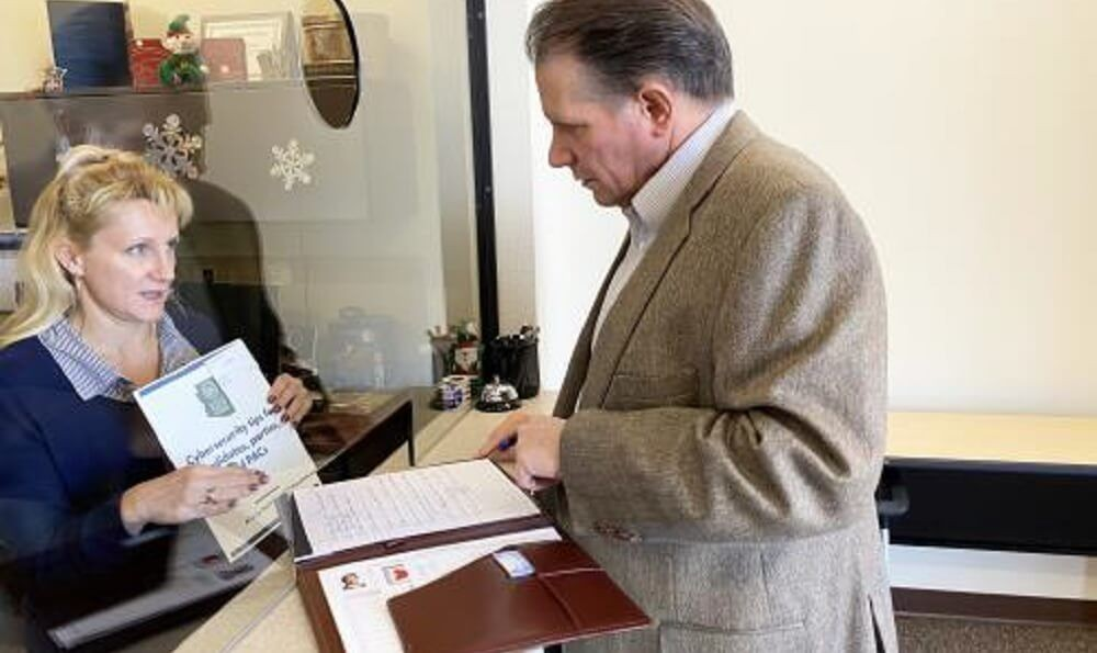 Pinal County Election Specialist Dana Lewis Accepts Former. Senator Chuck Gray's Election Documents. (Photo courtesy of Votechuckgray.com)