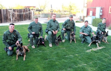 Members of PCSO K-9 are from left to right: Eric Berner and Aries, Daniel Richerson and Nauro, James Rimmer and Aza, Ashton Shewey and Kelly, Stan Jackon and Bikkel, Travis Williams and Russ. Not pictured are Dan McLean and LJ.